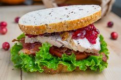 Roast Turkey Club Sandwich with Cranberry Sauce Recipe : A roast turkey sandwich with bacon, lettuce, tomato and cranberry sauce. The perfect way to enjoy leftover turkey! Turkey Club Sandwich, Turkey Sandwiches, Soup And Sandwich, Wrap Sandwiches, Sandwich Recipes, Sandwich Board, Paninis, Leftovers Recipes, Gourmet