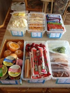 Tips for making school lunches (from a mother of 8) - DIY lunch bins. There is a number on the front of each bin which tells you how many items to pack. Then the kids can choose what items they want in their lunches. So smart!
