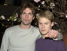 Actors Gale Harold left and Randy Harrison pose for photographers during a party for the Showtime television show 'Queer As Folk' March 19 2001 in...