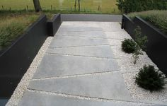 http://lerkefunkis.com/ Here is another example that shows how you can create exciting outdoor space with eksprementere with geometric shapes and different materials. Like the black concrete walls against the bright gravel and the polished concrete surfaces framing the bushes on the ground.