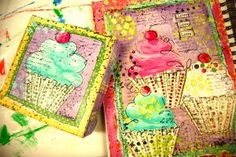 I love this picture because it shows you that my journal page inspired my canvas. I took the idea from my journal and put it on canvas. My art journal inspired a line of cupcakes to put in my etsy shop. So this week I will be designing cupcakes in my studio.