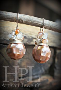 """Mother of pearl beadsSTERLING SILVER WIRE WRAPPED AND ADORNEDWITH FRESHWATER MINIATURE PEARLS, CZECH GLASS, AND CRYSTAL BEADS.Dangles from solid sterling silver earwiressimple but classic pair of earrings. they measure approx 1"""" H"""