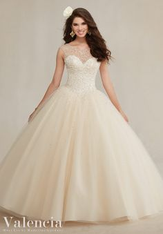 Quinceanera dresses by Vizcaya Beaded Tulle Ball Gown Matching Stole included.Colors: Mint Leaf, Champagne, Navy, White.