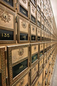Mail Call    		Art deco mail boxes extend, seemingly to infinity, at the Hollywood  branch of the Postal Service.