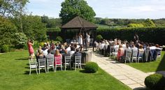 chiavari chairs - outdoor ceremony - south downs view - summer wedding - sussex weddings
