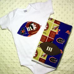 House Divided Football Onesie & Burp Cloth  FSU by SweetSeraphina, $22.50. Not so needed for 2012 but will be a necessity for 2013!