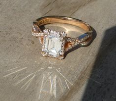 A lovely emerald-cut diamond set within a rose gold ring...sparkles in the sun! (style no. 2627 EC)