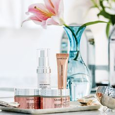 Corral skin-care products with pretty packaging on a shimmery silver tray! | Image: Stacey Brandford
