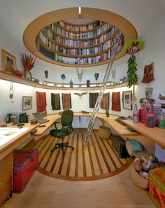 makes me think of a lighthouse outfitted with a library, just extend the circular library up through the body of the lighthouse around the ladder/s (either on wheels or spaced out so as to keep books within arm's reach)