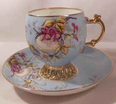 Imperial Russian Blue and Reticulated Gilt Cup & Saucer  Kuznetsov Porcelain Factory Circa 1900