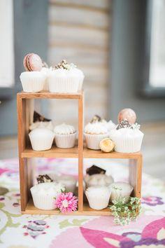 wedding cupcakes with chocolate and macarons on top