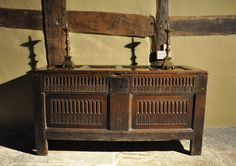 A FINE JAMES I OAK PANELLED COFFER. ENGLISH . CIRCA 1620.-THE FOUR PANELLED TOP WITH ORIGINAL HINGES ABOVE A FRONT WITH A STOP FLUTED TOP RAIL AND ORIGINAL LOCK PLATE.