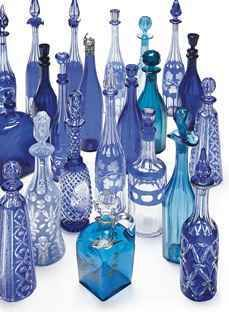 A collection of late 1800s blue decanters and stoppers sold at Christies