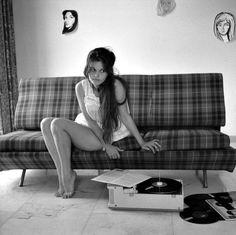 Original long hair era; Claudia Cardinale at home listening to Ella, Rome, 1959