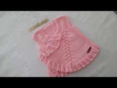 Fan vest knit baby vest with ruffles, It is a fan knitting model in one of the leading models of knitting models we encounter as a baby vest. The making of a fan baby vest is in this artic. Baby Knitting, Crochet Baby, Boho Shorts, Ruffles, Dressing, Wool, Children, Pretty, Baby Dresses