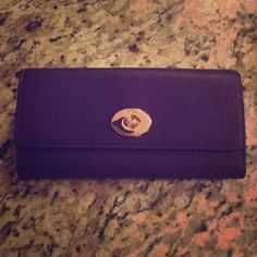 Purple Coach wallet. Purple coach wallet. Never been used, still has paper covering hardware. Comes with care instructions. Coach Bags Wallets
