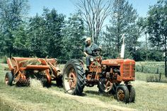 old time Tractor, Farmer, Farmall, Tractor, Baler, Hay Bale, Baleing Hay, Windrows