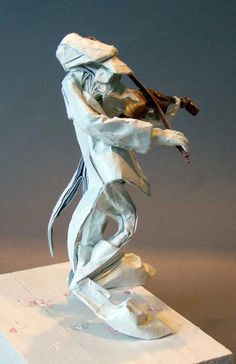 "The 8th musician in ""Spanish Orchestra"" by Eric Joisel (15 November 1956—10 October 2010), a French origami artist who specialized in the wet-folding method, creating figurative art sculptures using sheets of paper and water, without the use of any adhesive or scissors. Site: http://ericjoisel.com"