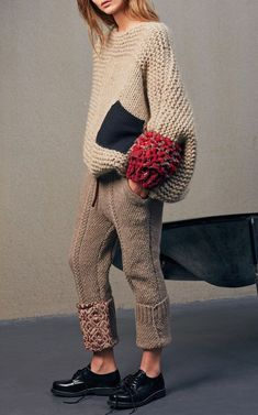 chunky beige color sweater with oversize black pocket and red sleeve detail, extremely chunky knitted sweater in nude, knitted pants,