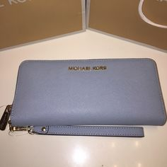 Michael Kors Authentic Continental Wallet BRAND NEW!!! Michael Kors continental wallet with removable strap. Saffiano leather. Pale blue color. Fits many cards, cash,coins and ID. Comes with all original tags and packaging Michael Kors Bags Wallets