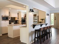 HGTV: After the Gaspar home got a much needed renovation, a breakfast bar was added.