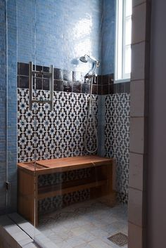 Love the black and white tile against the denim blue... Handmade tiles can be colour coordinated and customized re. shape, texture, pattern, etc. by ceramic design studios