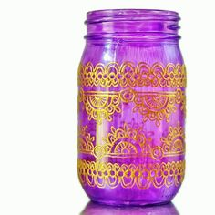 Set of 4 Moroccan Style Mason Jar Lanterns, Brilliant Spring Colored Glass with Henna Styled Accents. $98.00, via Etsy.