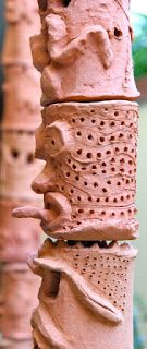 terra cotta totem pole by pieces