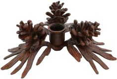 HomArt Cast Iron Pinecone Taper Holder, Brown by HomArt. $35.64. Each lifelike pine cone holds a tall, slender taper candle to create a friendly festive glow. Available in brown color. Measures 8-inch length by 8-inch width by 3-inch height. Made of cast iron. Pinecone taper holder. This exclusive collection of refined yet affordable home accessories is created for everyday use from all-natural, recycled, and new materials, simple and tastefully designed to comfortably...