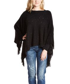 Black Fine Knit Fringe Poncho   This warm poncho features a relaxed silhouette that ensures a curve-conscious fit. The glittery sequins and fringe detailing lend fashion-forward style.   Fits sizes 2 to 12 30'' long from high point of shoulder to hem; 4'' fringe 100% acrylic Machine wash; dry flat Imported  Vegan Cruelty free Gorgeous!