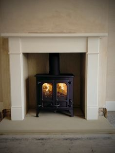 Charnwood Island 1, Brompton limestone surround with chamfered edge York stone hearth - Fahrenheit Stoves Ltd