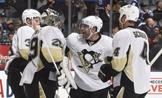 October 31, 2015 at Toronto: Phil Kessel, Olli Maatta and Rob Scuderi congratulate goaltender Marc-Andre Fleury, who picked up his league-leading second shutout in just 10 games this season. Eric Fehr and Matt Cullen also picked up their first goals with the team to help lead Pittsburgh to victory. Final score, 4-0 Penguins.