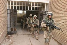 U.S. Marines from the 3rd Battalion 5th Marines seize apartments at the edge of Fallujah in November 2004.