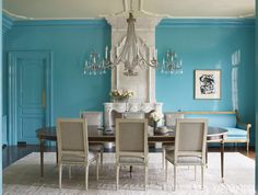 Gleaming Turquoise  From the walls and upholstery to the fine trim on the chairs, vibrant turquoise gives sparkle and shine to this Connecticut dining room.   Chandelier, David Iatesta. Table, Suzanne Kasler for Hickory Chair. Rug, Beauvais. Art, Franz Kline. Ceiling, Ralph Lauren Paint's Oyster.  INTERIOR DESIGN BY SUZANNE KASLER