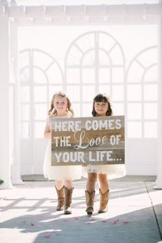 An adorable sign with cuties in cowboy boots: http://www.stylemepretty.com/california-weddings/2015/02/25/country-romance-at-delta-diamond/ | Photography: This Love of Yours - http://thisloveofyours.com/: