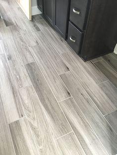 Newly installed gray weathered wood plank tile flooring  |  Mudroom & Foyer Ideas  |  Bathroom Ideas