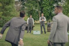 While the ladies are away, the boys will play. The groomsmen in this picture get in a quick game of corn-hole while the bridal party snaps a few pictures before the ceremony. McGuire's Millrace Farm can make their house set available for use by your guests! Who wouldn't want to play and laugh outside, on a joyous day in the gorgeous Western NC mountains.  Photo Credit- Heather Fink Photography