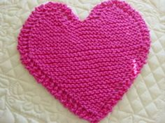 Bordered heart shaped dishcloth - free knit pattern via this link: http://tezsocks.wordpress.com/2008/02/01/bordered-heart-shaped-dishcloth/