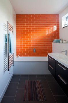 Looking for Subway Tiles for your Bathroom? Browse a full photo gallery of 20 Bathrooms Subway Tiles to get some design ideas for your Bathroom makeover. Orange Bathrooms, Rainbow Bathroom, Bathroom Red, Orange Tiles, Bathroom Decor Colors, Bathroom Interior, Painting Bathroom, Bathrooms Remodel, Bathroom Decor