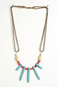 New - Turquoise Spike Necklace with Seed and Aftican Snake Beads on a Vintage Brass Snake Chain. $34.00, via Etsy.
