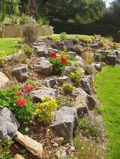How beautiful these boulders and pebbles retaining walls look! The most amazing design is that plants can be mixed into the wall area.