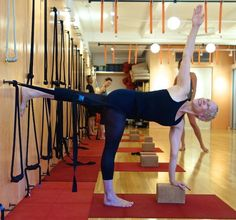 use rope wall to instruct thigh of standing leg to push back.  Iyengar Yoga.