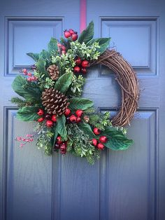 Pinecone Wreaths, Winter Door Wreaths, Green Red, Winter Decor, Grapevine Wreaths Winter, Christmas Wreaths This wreath is built on a 13 inch grapevine base but measures around 16 inches with the greenery. A lone pinecone is surrounded by beautiful green leaves, red berries and some evergreen stems. It is classic wreath that works perfectly at Christmas time and all Winter through. Please keep in mind that the majority of my wreaths are one of a kind and cannot be duplicated. If you are…