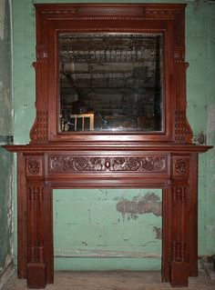Item ID: 102197  Description:Wooden fireplace mantel with paired turned colonette jambs, corner blocks with lion head motifs and carved frieze with arabesque design. Substantial overmantel has central beveled mirror, fluted engaged pilasters and decorative trim.Opening: 40.5W x 36H. Material:Wood Dimension: 72(W) 105(H) 16.75(D) Location:NYC-3 - See more at: http://www.demolitiondepot.com/vo/demo/inv/detail.asp?ID=102197#.dpuf