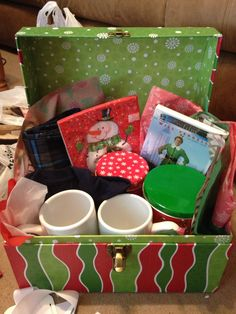 Christmas Eve box tradition I made this for my bf it went over great he loved it! I did new pjs custom coffee mugs with cocoa Andes mints homemade cookies and the movie elf:) all gifts under 20$ new tradition for us❤