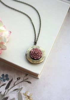 Hey, I found this really awesome Etsy listing at https://www.etsy.com/listing/182170885/dark-red-brown-rose-flower-locket