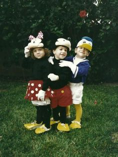 Disneyland Halloween costumes from the 90s.  Homemade with love by my Mom.  Minnie and Mickey Mouse, and Donald Duck