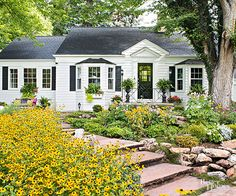 Get inspired by this beautiful cottage garden transformation! This outdoor space is successful because of the beautiful floral blooms, classic fountain, pretty patio, rustic garden gate, and other thoughtful details. You won't believe the incredible change until you see these amazing before-and-after photos that show how this boring yard became a beautiful garden!