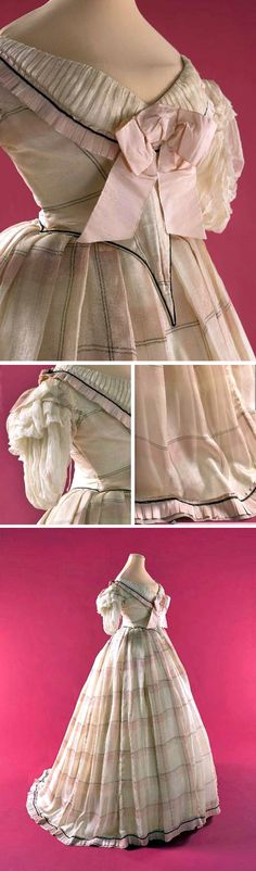 Ball gown, 1865. Two pieces. Beige silk chiffon with pink and b lack plaid, pink silk faille, pink silk ribbon, &white muslin. Skirt longer in back. Pleated hem. Boned bodice pointed front & back, rounded neckline effect; bertha with chiffon ribbons and pleated chiffon sleeves. Large double knot pink bow at center front. Musée Galliera