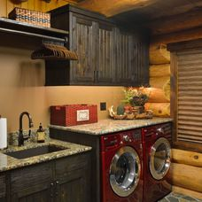 rustic laundry room by Lake Country Builders